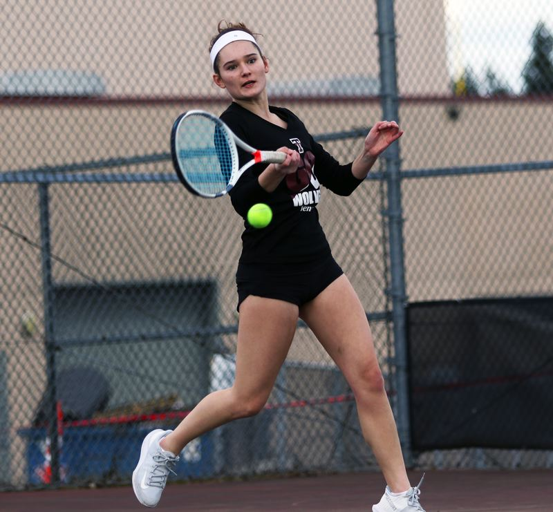 PMG PHOTO: DAN BROOD - Tualatin High School senior Jensen Barnes hits a shot during her 6-0, 6-0 victory in No. 1 singles play during the Wolves' 6-2 win over Tigard.