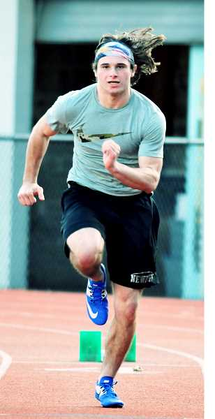 GARY ALLEN - Senior sprinter Matthew Larson is among the leaders for the Tigers' track team.