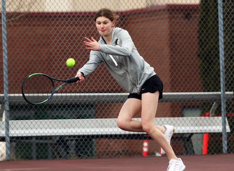 PMG PHOTO: DAN BROOD - Tigard junior Emma Parker goes after the ball during No. 1 singles play when the Tigers played at Tualatin last week.