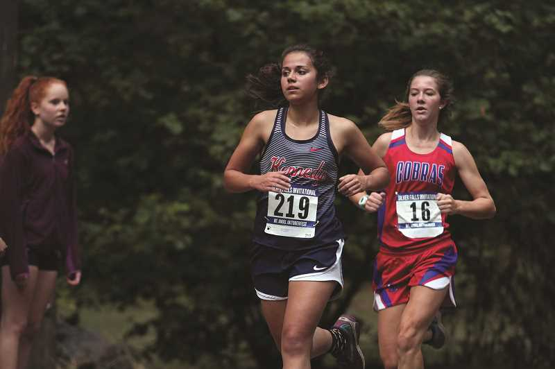 PMG PHOTO: PHIL HAWKINS - Lopez's time of 18:47.60 in the 5,000 is the second best mark in school history at JFK. She also holds the No. 2 spot in the school's 1,500 and 3,000 record books.