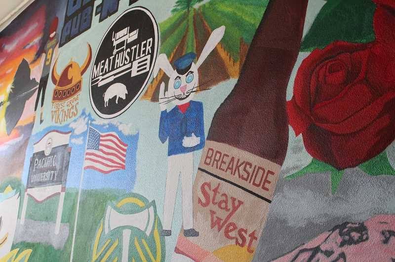 PMG PHOTO: JANAE EASLON - Boxer's Pub N Grub's mural, painted by resident Amy Moreno, depicts Oregon landmarks.