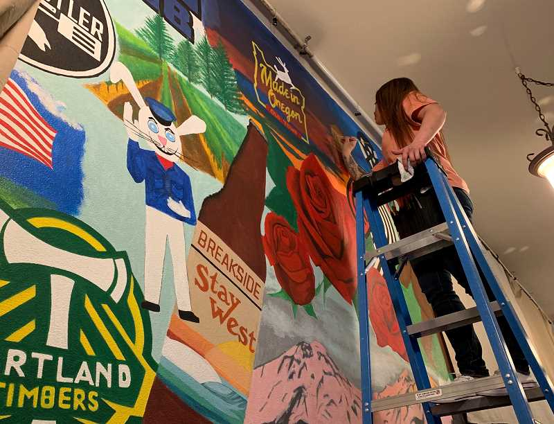 PMG PHOTO: JANAE EASLON - Boxer's Pub N Grub is owned by Rebekah Thomas, who commissioned the mural painted by resident Amy Moreno.