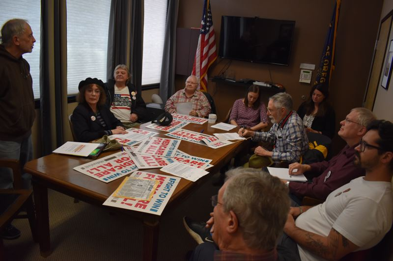 PMG PHOTO: RAYMOND RENDLEMAN - Dozens of people packed Congressman Kurt Schrader's office last Wednesday to tell his staffers that he was out of line with the Democratic Party by not supporting the Green New Deal and Medicare for All proposals.