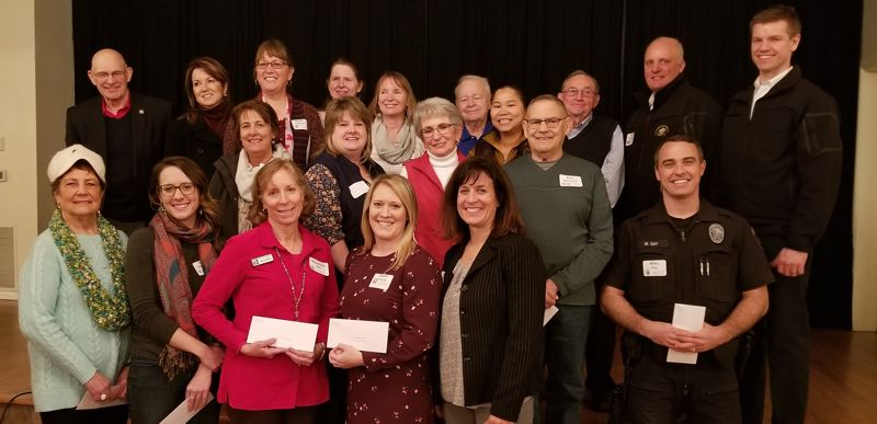 SUBMITTED PHOTO - Recipients of grants from the Oregon City Woman's Club included: Front row, left to right, Pauline Vorderstrasse, Start Right; Jenna Barganski, Clackamas County Historical Society; Maureen Cole, Oregon City Library; Jamie Davie, Pioneer Center Meals on Wheels; Shannon Kmetic, Angels In The Outfield; and Mike Day, OC Police Department Homeless Liaison Fund. Middle row, left to right:  Joan Jones, LOVE, Inc.; Amber Salvy, Pioneer Pantry (Oregon City High School); Nancy Doherty, Oregon City Backpack Buddies; Bruce Allen, HOPE (Helping Other People Eat). Top row, left to right: Ted Thonstad, Pioneer Pantry (Oregon City High School); Kathy Johnson, Oregon City High School; Robin Schmidt, The Fathers Heart; Amy Seymour, Oregon Department of Human Services; Jerry Kearney, Clackamas Emergency Services Foundation; Teresa Purett, Oregon Department of Human Resources; Don Trotter, Clackamas Emergency Services Foundation; Fred Charlton, Clackamas Emergency Services Foundation; and Brandon Paxton, Clackamas Emergency Services Foundation.