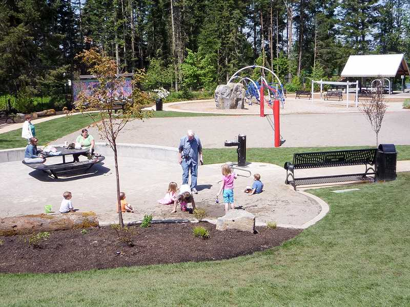 COURTESY PHOTO: CITY OF ESTACADA - Estacada residents enjoy the sand features at Wade Creek Park. The Estacada City Council recently approved an application for a grant from the Oregon Department of Parks and Recreation for additional projects at the park.