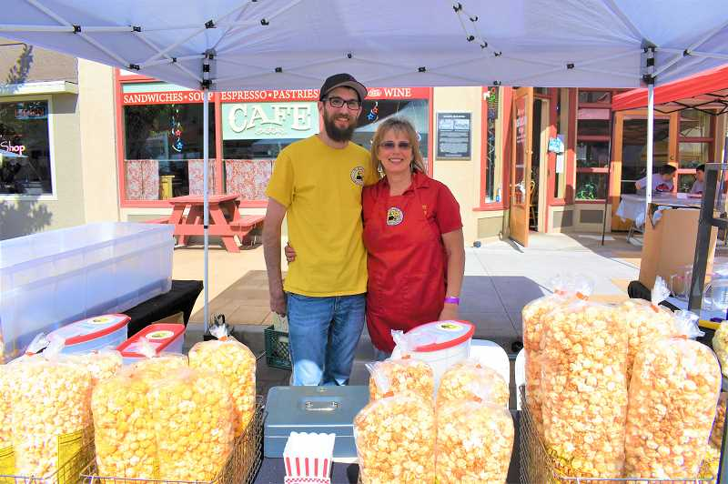 PMG PHOTO: EMILY LINDSTRAND - Trails End Kettle Corn owner Pam Pittman and her son, Travis, worked at last year's Estacada Uncorked celebration.