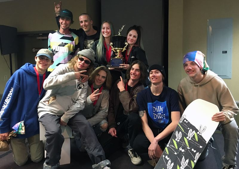 SUBMITTED PHOTO - The West Linn snowboard teams pose with the Sato Cup (held by Kyli Miller [left] and Ava Paul) after the Lions girls team took top honors at state.