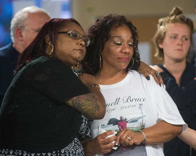 PMG FILE PHOTO - Christina Mines, right, the mother of 19-year-old Larnell Bruce during a candlelight vigil.