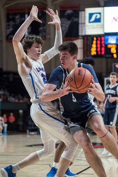 COURTESY PHOTO: GREG ARTMAN - The towering junior Dakota Reber was a big reason the boys were able to nab yet another title.