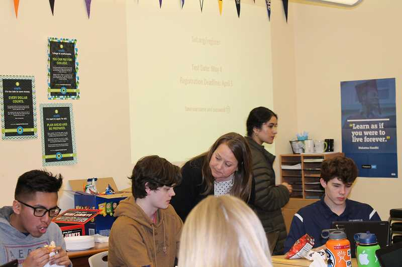 PMG PHOTO: HOLLY BARTHOLOMEW  - WHS juniors came to the College and Career Center at lunch time March 13 to get help registering for the SAT.