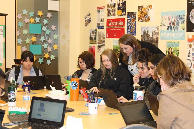 PMG PHOTO: HOLLY BARTHOLOMEW - College and Career Center staff help juniors register for the SAT later this spring.