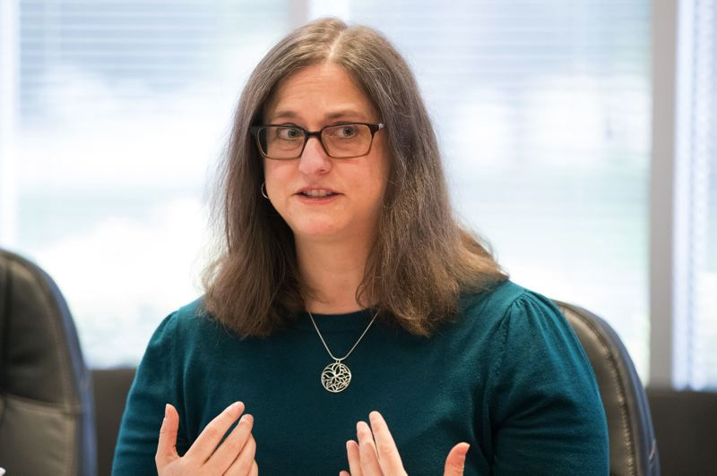 TRIBUNE FILE PHOTO - Newly elected Multnomah County Auditor Jennifer McGuirk, shown addressing the Tribune editorial board last year, has started off by putting a spotlight on the troubled county Department of Community Justice.