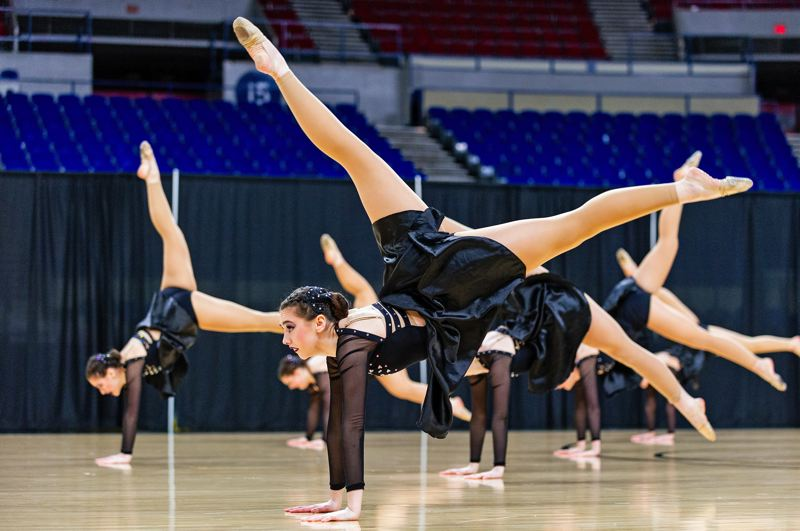 PMG PHOTO: JOHN LARIVIERE - Tigard dancers took top honors at the OSAA Dance and Drill state tournament. The team included Abby Mullins, foreground.