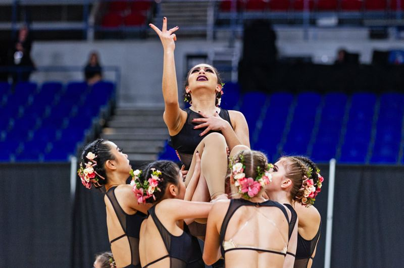 PMG PHOTOS: JOHN LARIVIERE - Sunset dancer Nora Giacchi gets a lift from her teammates.