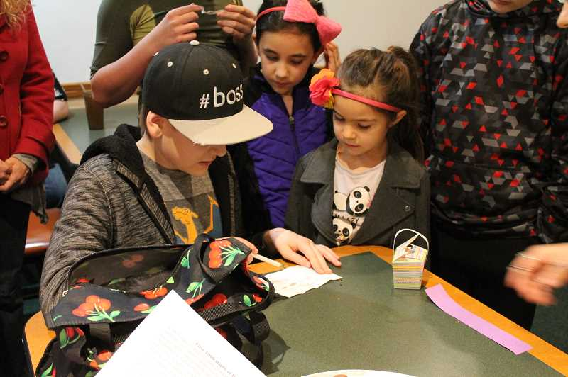 PMG PHOTO: HOLLY BARTHOLOMEW - Students from Oregon Connections Academy solve clues during a Pi day activity.