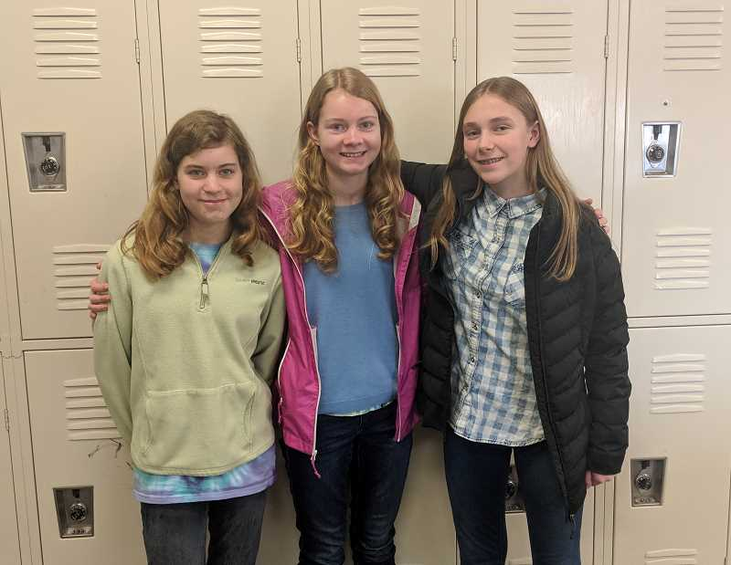 PMG PHOTO: EMILY LINDSTRAND - Among the members of Estacada Middle Schools Oregon Battle of the Books team were Sunflower Shaver, Heather Shaver and Luci Wainman.