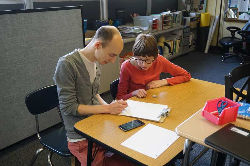 PMG PHOTO: CLAIRE HOLLEY - LOJ student Tessa Reville does some sketching with special education assistant Brandon Vance.