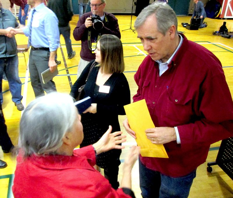 PMG PHOTO: KEVIN HARDEN - U.S. Sen. Jeff Merkley talked with people after his Yamhill County town hall Wednesday morning, March 20, at McMinnville's Community Center.
