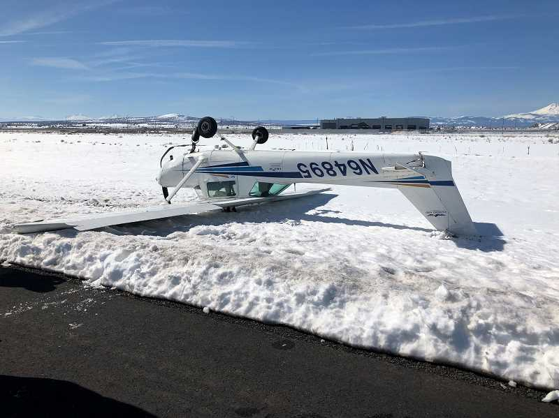 SUBMITTED PHOTO - The pilot of a Cessna single-engine plane that crashed at Madras Municipal Airport got himself out of the aircraft before emergency responders arrived.