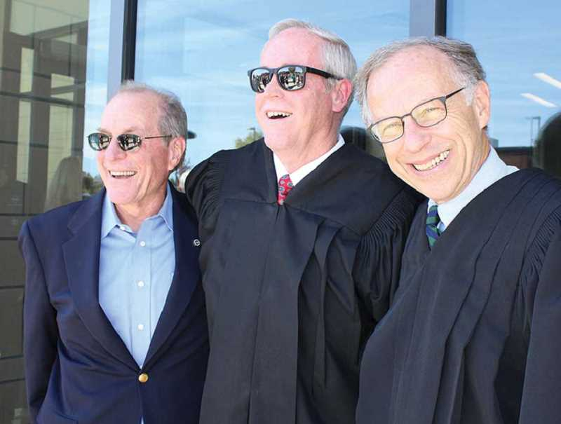 HOLLY M. GILL/MADRAS PIONEER - Judge Dan Ahern, center, is surrounded by former Gov. Ted Kulongoski, left, and the former chief justice of the Oregon Supreme Court, Thomas Balmer, during the ceremony celebrating the opening of the new Jefferson County Courthouse in September 2016.