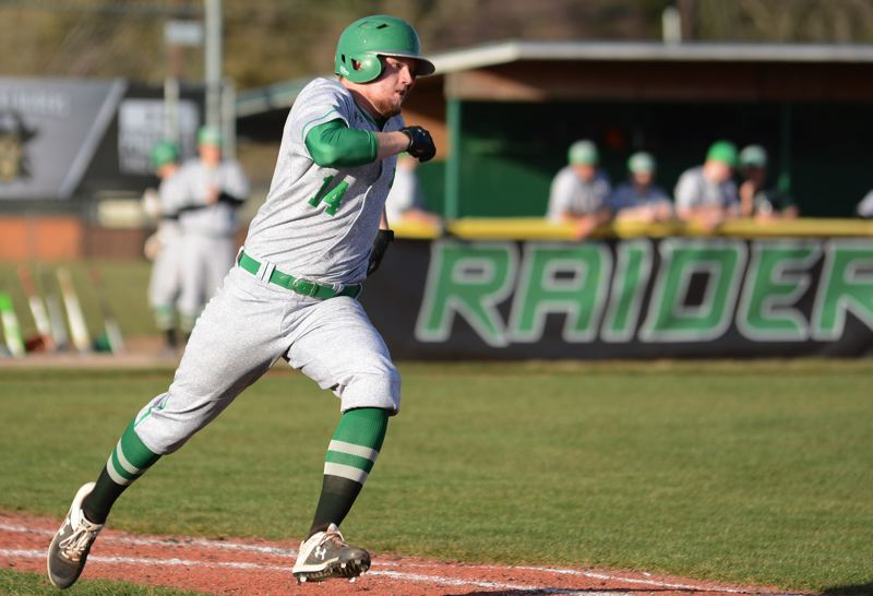 PMG PHOTO: DAVID BALL - Reynolds senior Spencer Verdieck prepares to round first base after coming up with a hit in the Raiders 17-7 home win over Roosevelt on Wednesday.