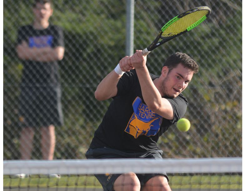 PMG PHOTO: DAVID BALL - Barlows Christian Maxey rushes the net for a backhand winner during his 7-6, 7-5 win in No. 1 singles Tuesday against Central Catholic.