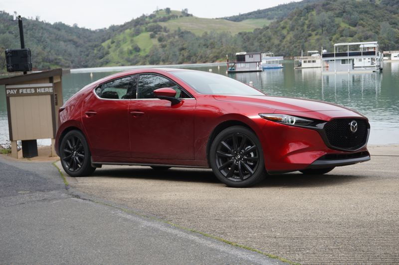 PORTLAND TRIBUNE: JEFF ZURSCHMEIDE - The Mazda3 has been compleltely redesigned and is available with front-wheel-drive or optional all-wheel-drive.