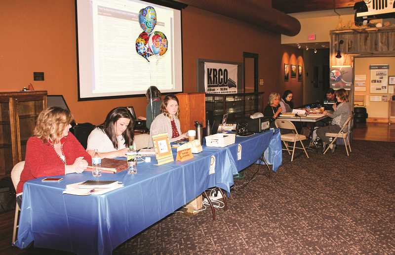 CENTRAL OREGONIAN FILE PHOTOS  - During the 2018 Rotary on the Radio fundraising event, Crook County Rotary Club members took turns being radio DJs, manning the phones, and updating auction bids from their headquarters at the Bowman Museum.