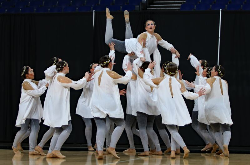 PMG PHOTO: JIM BESEDA - The Scappoose Vision Dance Team competes in the state dance/drill championships, and in this performance of 'Fallen,' archangels lift up their fallen angel, Hannah Darco, in an attempt to keep them with her.