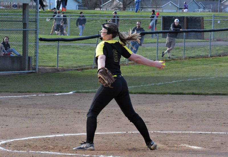 PMG PHOTO: MATT SINGLEDECKER - St. Helens pitcher Brea Paulson gets the win for the Lions on Tuesday against South Albany.