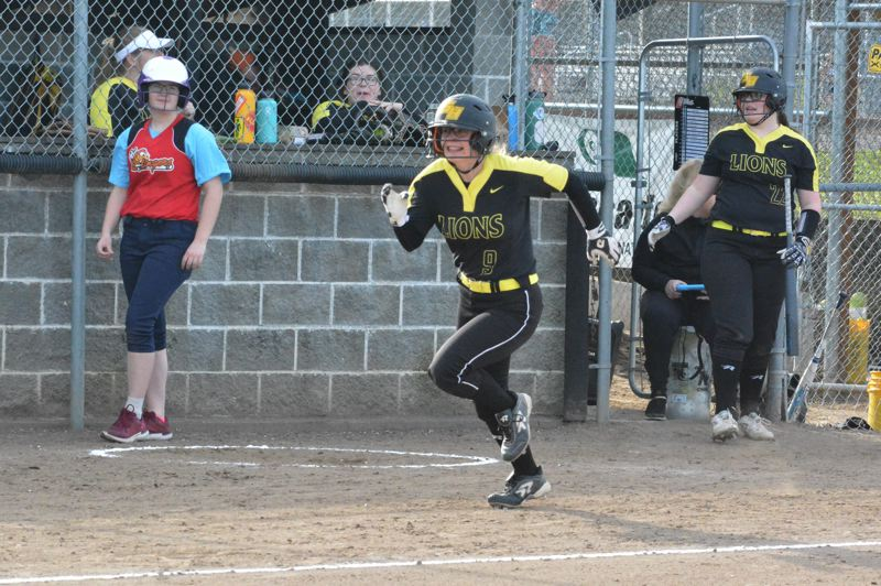 PMG PHOTO: MATT SINGLEDECKER - St. Helens catcher Jasmyne Pense makes a break for home plate during Tuesday's 5-4 home victory over South Albany.