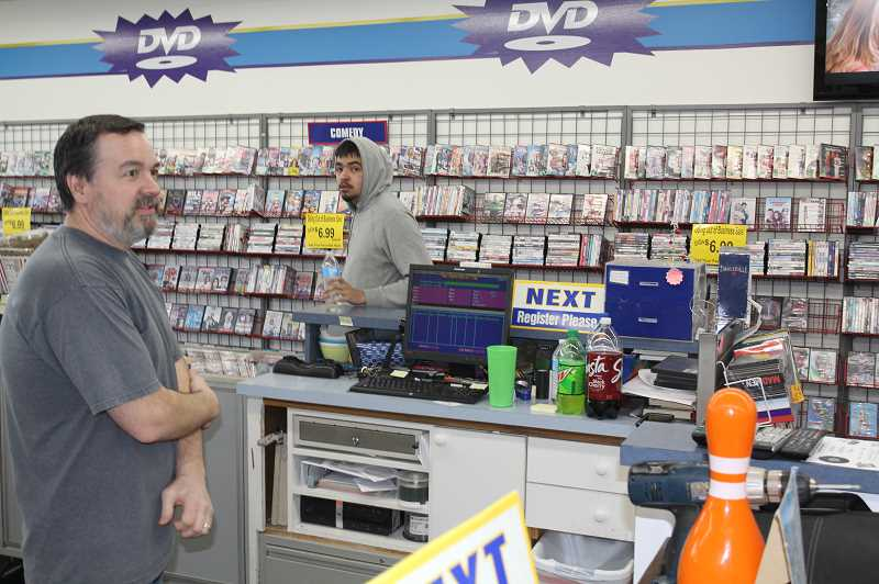 PMG PHOTO: JUSTIN MUCH - Tim Wallace has been in the video business 38 years, beginning at age 14 when he went to work at his parents then fledgling store.