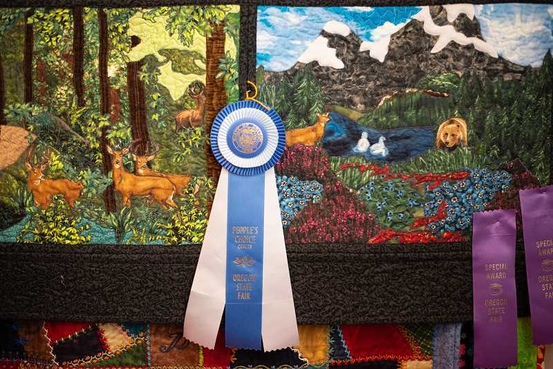 PMG PHOTO: ANNA DEL SAVIO - Phyllis' first applique quilt hangs in her bedroom with award ribbons pinned to it.
