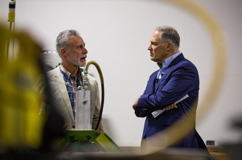 BRADLEY W. PARKS - Presidential hopeful and Washington Gov. Jay Inslee, right, speaks with International Brotherhood of Electrical Workers Local 48 business manager Gary Young at the IBEW training center in Portland, Ore., Saturday, March 23, 2019. Inslee is visiting cities across the country as part of the Climate Mission Tour in the early stages of his presidential compaign.