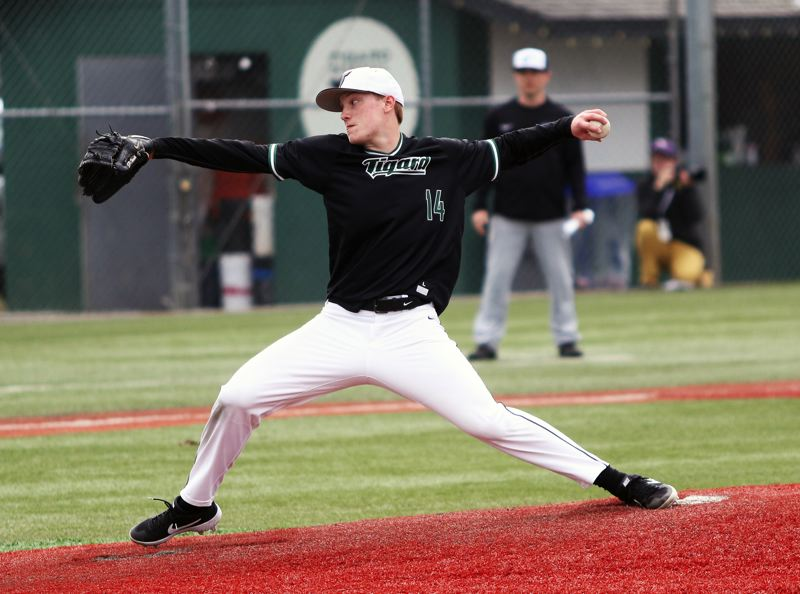 PMG PHOTO: DAN BROOD - Tigard senior Fletcher Ahl gets ready to throw a pitch during the Tigers' game with Century on Saturday.