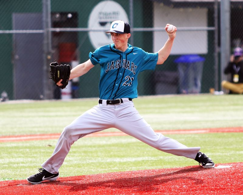 PMG PHOTO: DAN BROOD - Century senior Micky Thompson gets ready to fire in a pitch for the Jaguars in their game at Tigard on Saturday.