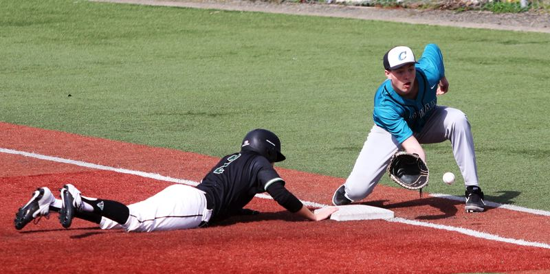 PMG PHOTO: DAN BROOD - Century senior Kyler Somers (right) reaches for the ball as Tigard senior Caden Stinson dives back to first base on a pickoff play during Saturday's game.