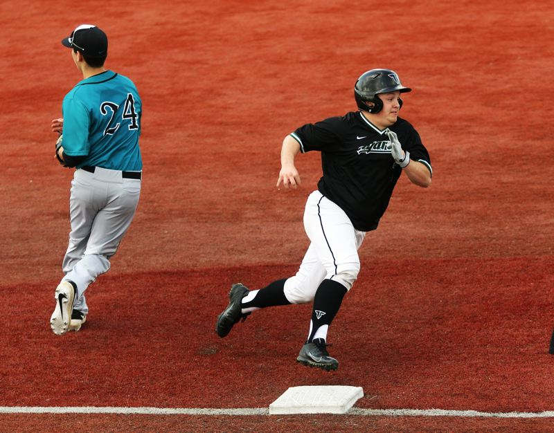 PMG PHOTO: DAN BROOD - Tigard junior Mikey McNamee (right) rounds third base and heads home on his way to scoring a fifth-inning run during the Tigers' game with Century.