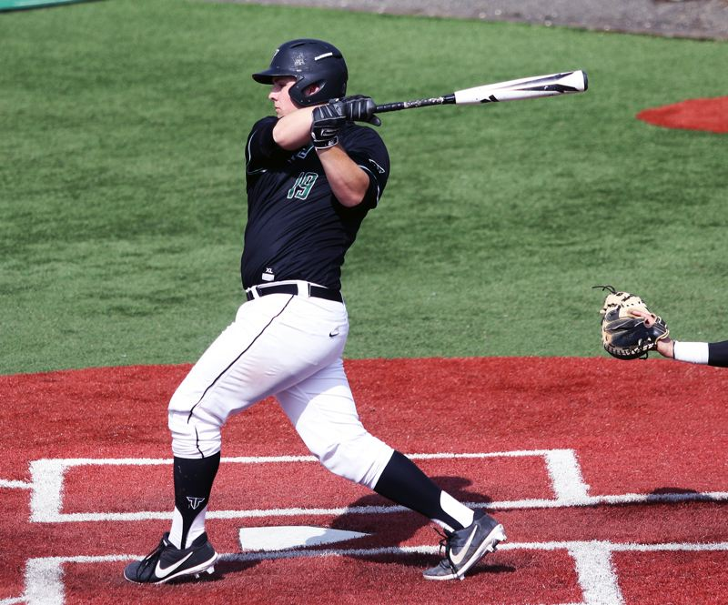 PMG PHOTO: DAN BROOD - Tigard senior C.J. Rivers takes a swing during the Tigers' game with Century on Saturday.