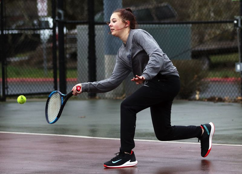 PMG PHOTO: DAN BROOD - Sherwood High School senior Emily McDonald hits a forehand shot during her No. 1 singles match against Century.