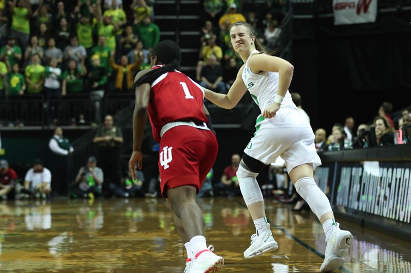 PMG PHOTO: JAIME VALDEZ - Oregon guard Sabrina Ionescu winks toward the bench after hitting a 3-pointer against Indiana.