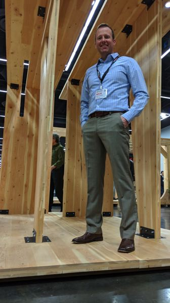 PAMPLIN MEDIA GROUP: JOSEPH GALLIVAN - Nick Desimone of SmartLam on a wooden structure that he called an inspiration — a demonstration piece that highlights how CLT can be used.