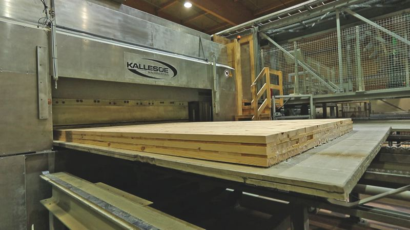 COURTESY: KALLESO - A Kallesoe press from Denmark showing how mass timber is glued, heated by radio waves and pressed to make rigid panels for building.