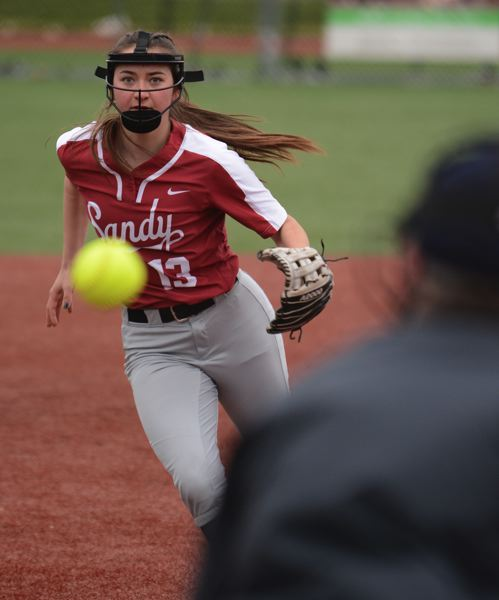 PMG PHOTO: DAVID BALL - Sandys Brooklyn Adams rushes down the third-base line to cover a bunt during the opener of the Pioneers spring break tournament Monday morning.