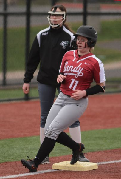 PMG PHOTO: DAVID BALL - Sandys lead-off hitter Katie Bruner arrives at third base on her way to scoring in the fifth inning.