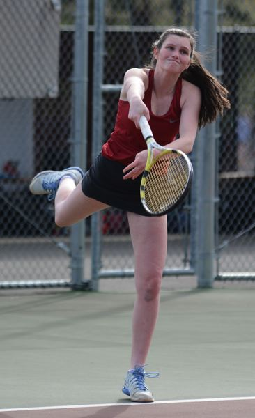 PMG PHOTO: DAVID BALL - Sandys Sydney Stratton hits a serve during the Pioneers win atop the doubles ladder.