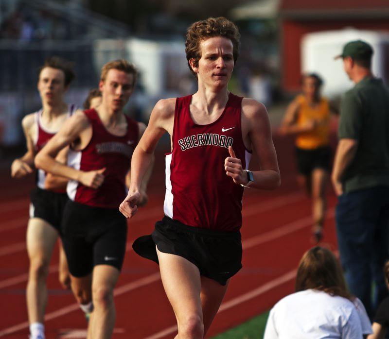 PMG PHOTO: DAN BROOD - Sherwood High School senior Henry Giles took first place in the 1,500-meter run during the Bowmen's conference dual meet with Forest Grove.