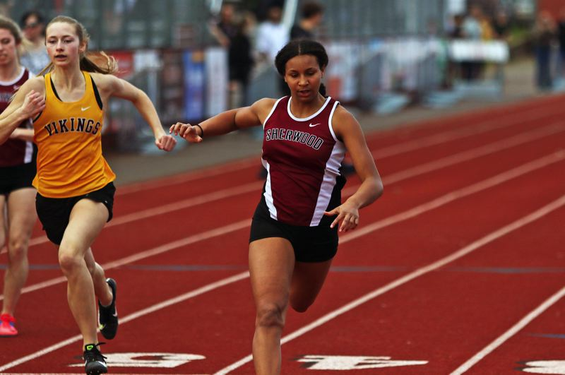 PMG PHOTO: DAN BROOD - Sherwood High School sophomore Nora Hagan won both the 100 and the 200, helping they Lady Bowmen defeat Forest Grove in last week's dual meet.
