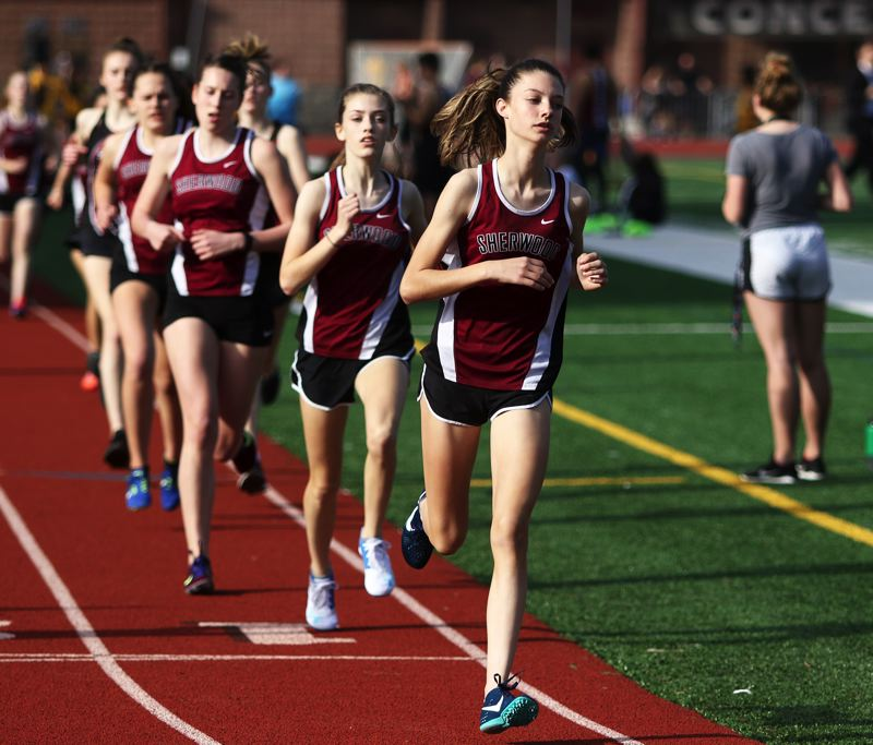 PMG PHOTO: DAN BROOD - Sherwood High School freshman Taylor Card leads the pack on her way to winning the 1,500-meter run during the meet with Forest Grove.