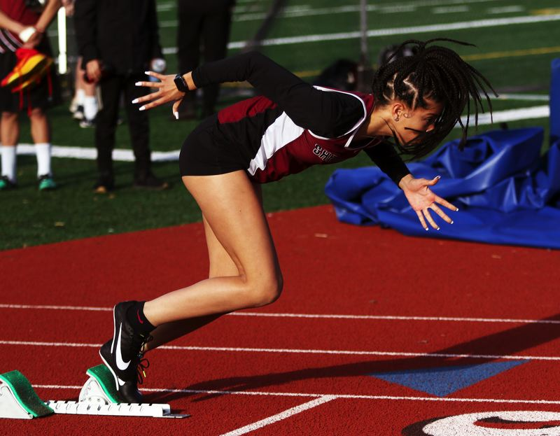 PMG PHOTO: DAN BROOD - Sherwood High School sophomore Kylah Williams takes off out of the blocks on her way to winning the 400-meter dash in the meet with Forest Grove.